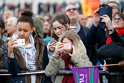 © Licensed to London News Pictures. 01/05/2017. London, UK. Young people looking at their phones during a May Day rally in Trafalgar Square on May 1, 2017. Photo credit: Tolga Akmen/LNP
