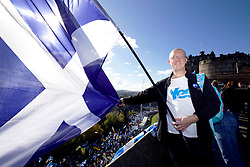 Network Rail engineer Kenneth Lowe from Giffnock on the Castle Esplanade overlooking a march by independence campaigners, Edinburgh pic copyright Terry Murden @edinburghelitemedia