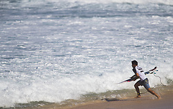 December 8, 2017 - Banzai Pipeline, HI, USA - BANZAI PIPELINE, HI - DECEMBER 8, 2017 - A surfer sprints into the water to compete in the World Surf League Men's Pipe Invitational at Backdoor Pipeline  Friday to qualify for the upcoming Billabong Pipe Masters. (Credit Image: © Erich Schlegel via ZUMA Wire)