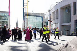 © Licensed to London News Pictures. 25/3/2016. Birmingham, UK. Good Friday Walk of Witness. Churches in Birmingham come together to walk through Birmingham City Centre, visiting Cathedrals and Churches.<br /> Pictured, the procession walks past the Bullring. Photo credit : Dave Warren/LNP
