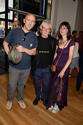 MARK BEDFORD founding member of the band Madness, DAVEY PAYNE saxaphone player in the Blockheads and JUDITH PAYNE at a private view of the late Ian Dury's artwork entitled Ian Dury: More Than Fair – Paintings, drawings and artworks, 1961–1972 held at the Royal College of Art, Kensington Gore, London SW7 on 22nd July 2013.