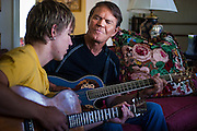 02 SEPTEMBER 2004 - PHOENIX, AZ:  CAL CAMPBELL, (left) and his father,  music legend GLEN CAMPBELL in the Campbell home in the Biltmore section of Phoenix, AZ.   PHOTO BY JACK KURTZ