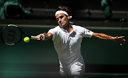 LONDON, July 2, 2018  Roger Federer of Switzerland hits a return during the men's singles first round match against Dusan Lajovic of Serbia at the Championship Wimbledon 2018 in London, Britain, on July 2, 2018. Roger Federer won 3-0. (Credit Image: © Tang Shi/Xinhua via ZUMA Wire)