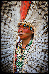 August 23, 2019, London, England, United Kingdom: Wearing Amazonian indian head-dress, environmentalists protest at the Brazilian embassy in London over Brazils inaction to tackle the wild fires sweeping through the Amazon rainforest. (Credit Image: © Martyn Wheatley/i-Images via ZUMA Press)
