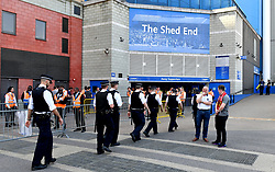 Police patrol the area before the Premier League match at Stamford Bridge, London.