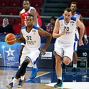 Anadolu Efes's Brian Hopson (L) and Dusko Savanovic (R) during their Turkish Basketball League match Anadolu Efes between Tofas at the Abdi ipekci Arena in Istanbul, Turkey on Tuesday, 24 December, 2013. Photo by TURKPIX