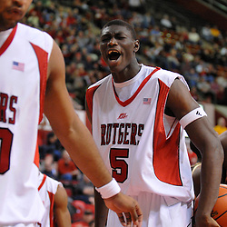 Nov 23, 2008; Piscataway, NJ, USA; Rutgers center Hamady N'Diaye (5) screams encouragement towards teammate forward Gregory Echenique (00) after Echenique scored a slam dunk during the closing stages of Rutgers 54-53 loss to St. Bonaventure at the Louis Brown Rutgers Athletic Center.