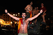 Spanish fans climb into the fountain in Trafalgar Square in central London after Spain beat Holland in the final of the soccer world cup,July 11,2010. It is the first time in the country's history that they have won the trophy.