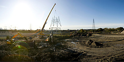 Olympic Village. Panoramic view of crane and workers at height dismantling of YYJ chain National Grid pylon. Picture taken on 29 Oct 2008 by David Poultney.