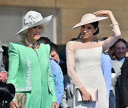The Duchess of Cornwall (left) the Duchess of Sussex during a garden party at Buckingham Palace in London which she is attending as her first royal engagement after being married.