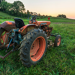 A tractor on a farm on Kinney Hill in South Hampton, New Hampshire. Sunrise.