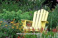 63821-14108 Yellow Adirondack chair in flower garden - Marion Co., IL