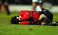 Ruud Van Nistelrooy agony after crunch tackle<br /> Manchester United 2004/05<br /> Manchester United V Milan 23/02/05<br /> The UEFA Champions League<br /> Photo Robin Parker Digitalsport