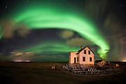 Encircled by Aurora Borealis, Abandoned farm Hólmur in Reykjanes, west Iceland