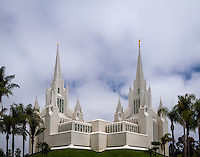 The gorgeous San Diego LDS Temple on a warm Summer day in sunny Southern California as it sits among the beautifully landscaped flower gardens and neighborhood.
