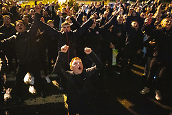© Licensed to London News Pictures. 09/05/2021. Bolton, UK. Bolton Wonderers supporters cheer outside the team hotel at the University of Bolton stadium as their team coach returns home following BWFC winning promotion to League One after the team's 1-4 victory over Crawley Town . Photo credit: Joel Goodman/LNP