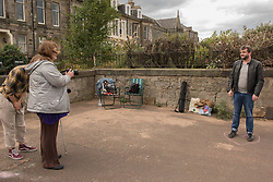 Portobello, Edinburgh's seaside suburb, is awash with Art. Almost everywhere you look there is something to see as the Art Walk Porty community art festival takes place, now extended to run over ten days covering the first two weekends of September. Pictured: Blind Photographer Rosita McKenzie is running a photobooth on the prom with a print made while you wait.<br /> <br /> <br /> © Jon Davey/ EEm