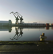 Two shipping cranes lie disused in a former dockyard at West Float, Wallasey on the river Mersey. The Mersey is a river in north west England which stretches for 70 miles (112 km) from Stockport, Greater Manchester, ending at Liverpool Bay, Merseyside. For centuries, it formed part of the ancient county divide between Lancashire and Cheshire.
