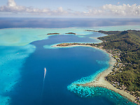 Aerial view of a boat in the bay of Bora-Bora, French Polynesia.