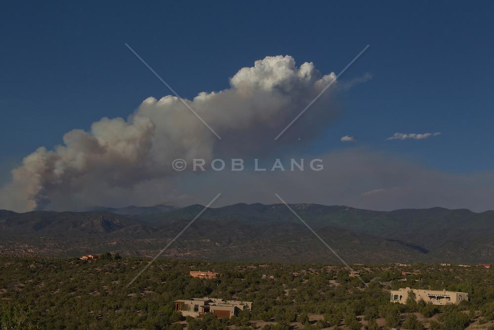 fire above the Santa Fe Mountains in Santa Fe, NM