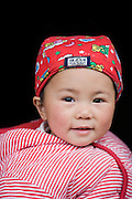 Baby girl in Fuli Old Town, Xingping, China