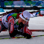 Winter Olympics, Vancouver, 2010.Zina Kocher, Canada, feels the pain after finishing during the Women's 7.5 KM Sprint Biathlon at The Whistler Olympic Park, Whistler, during the Vancouver  Winter Olympics. 13th February 2010. Photo Tim Clayton