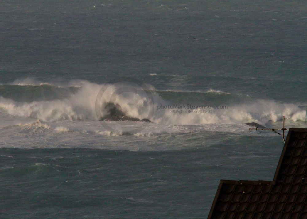 50 foot waves breaking over Poiahine/White island today.<br /> White Island is an island 2,500 metres (2,700 yd) off the coast of Otago, within the boundaries of the city of Dunedin, South Island, New Zealand. It is uninhabited, and is a well-known landmark visible from the city's two inner city beaches at St Clair and St Kilda. The island is 80 metres (87 yd) in length and 30 metres (33 yd) wide at its widest point, covering 1,600 square metres (17,000 sq ft) and rising to a height of approximately 15 metres (49 ft). <br /> (Wikipedia)