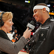 Carmelo Anthony talks with ESPN Radio before the start of the All-Star game in Houston. ©Travis Bell Photography