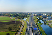 Nederland, Gelderland, Veenendaal, 24-10-2013. Autosnelweg A12 tussen Ede en Veenendaal, knooppunt Maanderbroek (A30). Rechts bedrijventerrein.<br /> Motorway A12 near Ede, central Netherlands. <br /> luchtfoto (toeslag op standaard tarieven);<br /> aerial photo (additional fee required);<br /> copyright foto/photo Siebe Swart.