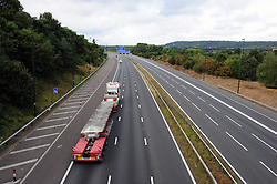 © Licensed to London News Pictures. 28/08/2016<br /> M20 BRIDGE COLLAPSE,KENT.<br /> <br /> The bridge is taken away by a transporter lorry towards London on an empty M20 motorway.<br /> <br /> <br /> The M20 is still closed today after a pedestrian bridge collapsed on to the motorway after being struck by a digger on a transporter lorry.  Emergency work to clear the scene is continuing with engineers working all night.<br /> (Byline:Grant Falvey/LNP)