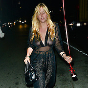 Scout LaRue Willis topless - shows off naked breasts in L.A.<br /> <br /> Scout Willis appears in a see-through dress with no bra on. Her breasts can be very clearly seen. She is out and about with a friend and holds a red balloon on a string in her hand. Her hair hangs down in her face and she appears to be a little drunk and not quiet with it. Los Angeles, California, <br /> ©Exclusivepix Media