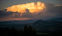 A thunderhead over the Jackson Hole valley at sunset on a summer evening.