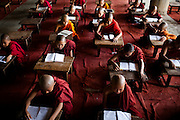 With the number of residents too many for the original monastery, younger monks reside and study in an unfinished concrete building adjacent to the monastery.