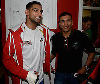 Dec 11,2012.  Montebello CA. USA.  Amir Khan(L) poses with pro boxer Ponce De Leon during a media day Tuesday afternoon at the Ponce De Leon Boxing Club.  Amir Khan will be fighting Carlos Molina this Saturday night at the Los Angeles Sports Arena live on ShowTime. .Photo By Gene Blevins/LA Daily News