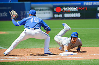 Aug 2, 2015; Toronto, Ontario, CAN; Kansas City Royals left fielder Ben Zobrist (18) dives back to first base from a throw by Toronto Blue Jays pitcher R.A. Dickey (43)  in the fourth inning at Rogers Centre. Mandatory Credit: Peter Llewellyn-USA TODAY Sports