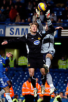 Photo: Ed Godden/Sportsbeat Images.<br />Chelsea v Wigan Athletic. The Barclays Premiership. 13/01/2007. Wigan's Andreas Johansson collides with Chelsea keeper Henrique Hilario.