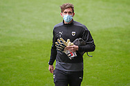AFC Wimbledon goalkeeper Sam Walker (1) arriving for the game wearing face mask during the EFL Sky Bet League 1 match between AFC Wimbledon and Sunderland at Plough Lane, London, United Kingdom on 16 January 2021.