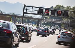 """THEMENBILD - Stau auf der A8 Richtung Salzburg. Auf einem Überkopfwegweiser sind das Verkehrsschild """"Stau"""" und """"LKW Überholverbot"""" zu sehen. Zur Urlaubs- und Reisezeit kommt es immer wieder zu starkem Verkehrsaufkommen, aufgenommen am 21. Juli 2019, Irschenberg, Deutschland // Traffic jam on the A8 towards Salzburg. The traffic signs """"Stau"""" and """"LKW Überholverbot"""" can be seen on an overhead signpost. During the holiday and travel season there is always a lot of traffic on 2019/07/20, Irschenberg, Germany. EXPA Pictures © 2019, PhotoCredit: EXPA/ Stefanie Oberhauser"""