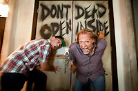 Halloween Horror Nights Creative Director John Murdy, left,  with The Walking Dead co-executive producer Greg Notero in the Walking Dead maze September 4,  2012. Photo by David Sprague