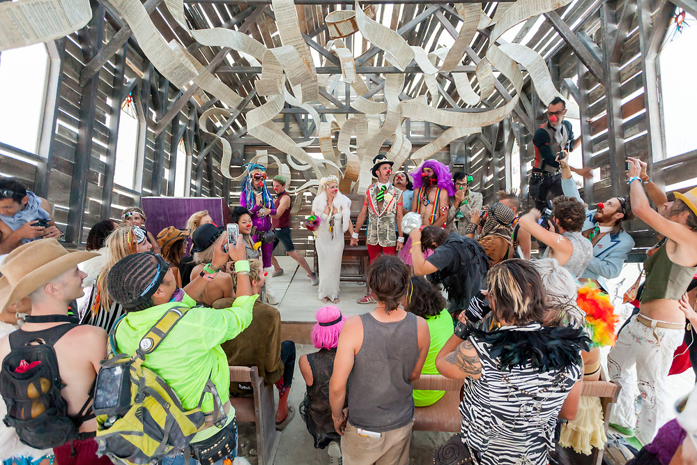 """Wedding at the Church Trap by: Rebekah Waites from: lakewood, CA year: 2013<br /> <br /> Church Trap is an interactive wonderland for the religiously rebellious. A large-scale decaying church, tipped on its axis like a box trap. Not only does it push participants to ask the question """"why"""", but it also invites the daring to take control of the many interactive features. A tricked out church organ, part central LED nervous system, part beautifully wicked installation art. It is your God. Or, are you its? Whatever the answer, play at your own risk. Feeling even more daring? Why not put your spiritual and religious beliefs to test by playing The Machine – an 80's style upright video game. It might want to play """"pulpit"""", but it's all """"confessional"""". URL: http://www.churchtrap.com Contact: rebekart@yahoo.com"""