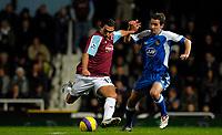 Photo: Alan Crowhurst.<br />West Ham United v Wigan Athletic. The Barclays Premiership. 06/12/2006. Carlos Tevez (L) shoots for West Ham.