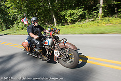 Ron Roberts riding his 1936 Indian Chief during Stage 5 of the Motorcycle Cannonball Cross-Country Endurance Run, which on this day ran from Clarksville, TN to Cape Girardeau, MO., USA. Tuesday, September 9, 2014.  Photography ©2014 Michael Lichter.