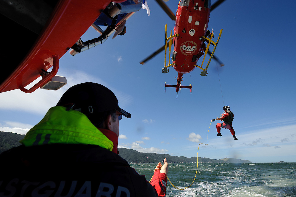 Life Flight Trust editorial coverage. January, 2012. Winch training as shot from the Wellington Coast Guard vessle...Photo by Mark Tantrum   www.marktantrum.com