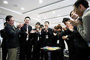 Students cheer after completing a puzzle at a management training class at the McDonalds Hamburger University in Shanghai, China on Thursday, 13 january 2011.  McDonalds claim that the university's selection criteria is even more stringent than that of Harvard.