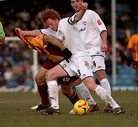 Photo: Ian Hebden.<br />Milton Keynes v Bradford City. Coca Cola League 1. 25/02/2006.<br />MK Dons Dean Lewington (R) challenges Bradfords Danny Cadamarteri (L).