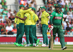 South Africa's Andile Phehlukwayo (second left) celebrates after taking the wicket of Bangladesh's Tamim Iqbal during the ICC Cricket World Cup group stage match at The Oval, London.