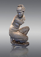 Crouching Aphrodite (Venus). 2nd Century  Roman Marble Statue from Marmol. Cordoba Archaeological Museum, Spain.<br /> This sculpture  is a variation on the Classic Hellanistic 3rd to Ist century BC style of Aphrodite crouching to bathe. Aphrodite crouches with her right knee close to the ground, turns her head to the right as if looking at somebody and, in most versions, reaches her right arm over to her left shoulder to cover her breasts. .<br /> <br /> If you prefer to buy from our ALAMY STOCK LIBRARY page at https://www.alamy.com/portfolio/paul-williams-funkystock/greco-roman-sculptures.html . Type -    Cordoba     - into LOWER SEARCH WITHIN GALLERY box - Refine search by adding a subject, place, background colour, museum etc.<br /> <br /> Visit our ROMAN WORLD PHOTO COLLECTIONS for more photos to download or buy as wall art prints https://funkystock.photoshelter.com/gallery-collection/The-Romans-Art-Artefacts-Antiquities-Historic-Sites-Pictures-Images/C0000r2uLJJo9_s0