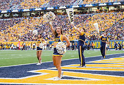 Oct 2, 2021; Morgantown, West Virginia, USA; West Virginia Mountaineers cheerleaders perform during the fourth quarter against the Texas Tech Red Raiders at Mountaineer Field at Milan Puskar Stadium. Mandatory Credit: Ben Queen-USA TODAY Sports