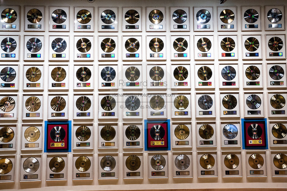 Museum display of wall of gold records at the Country Music Hall of Fame in Nashville, TN.
