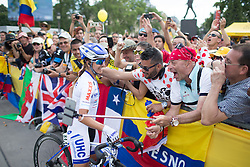 Diana Penuela Martinez (COL) of UnitedHealthcare Cycling Team enjoys the love of Colombian supporters after finishing the La Course, a 89 km road race in Paris on July 24, 2016 in France.